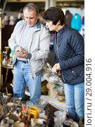 Купить «Modern man and woman at traditional flea market», фото № 29004916, снято 23 октября 2017 г. (c) Яков Филимонов / Фотобанк Лори