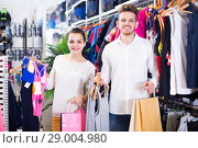Купить «couple boasting various purchases in sports store», фото № 29004980, снято 22 ноября 2016 г. (c) Яков Филимонов / Фотобанк Лори