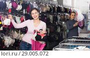 Купить «Young glad woman shopping lace uplifts», фото № 29005072, снято 23 октября 2018 г. (c) Яков Филимонов / Фотобанк Лори