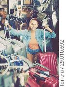Купить «positive teenager girl choosing new large plastic luggage bag», фото № 29010692, снято 15 сентября 2016 г. (c) Яков Филимонов / Фотобанк Лори