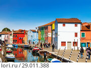Купить «Bright colourful houses in  Burano island on the edge of the Venetian Lagoon. Venice, Italy,», фото № 29011388, снято 17 апреля 2017 г. (c) Наталья Волкова / Фотобанк Лори