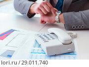 Купить «Businessman expecting important call on phone», фото № 29011740, снято 2 марта 2017 г. (c) Elnur / Фотобанк Лори