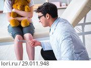 Купить «Doctor checking up young girls reflexes with hammer», фото № 29011948, снято 6 марта 2018 г. (c) Elnur / Фотобанк Лори