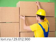 Купить «Man contractor working with boxes delivery», фото № 29012900, снято 4 июня 2018 г. (c) Elnur / Фотобанк Лори