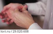 Купить «Businessman Dresses His Watch And Adjusts Outfit», видеоролик № 29020608, снято 31 июля 2018 г. (c) Pavel Biryukov / Фотобанк Лори