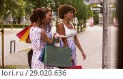 Купить «women with shopping bags looking at shop window», видеоролик № 29020636, снято 15 августа 2018 г. (c) Syda Productions / Фотобанк Лори