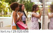 Купить «women with shopping bags looking at shop window», видеоролик № 29020656, снято 15 августа 2018 г. (c) Syda Productions / Фотобанк Лори