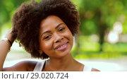 Купить «happy african american young woman outdoors», видеоролик № 29020724, снято 15 августа 2018 г. (c) Syda Productions / Фотобанк Лори
