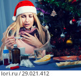 Купить «Unhealthy female is sitting in a plaid with medications in the New Year night», фото № 29021412, снято 6 января 2018 г. (c) Яков Филимонов / Фотобанк Лори