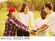 Купить «Young girls and boys posing in spring park», фото № 29021476, снято 19 октября 2018 г. (c) Яков Филимонов / Фотобанк Лори