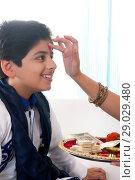 Купить «Sister applying tilak to her brother at Bhaidooj», фото № 29029480, снято 8 октября 2013 г. (c) easy Fotostock / Фотобанк Лори