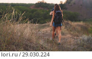 Купить «Couple walking with backpacks», видеоролик № 29030224, снято 31 августа 2018 г. (c) Илья Шаматура / Фотобанк Лори