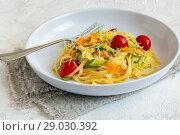 Купить «Homemade pasta with strips of zucchini and carrots», фото № 29030392, снято 7 августа 2018 г. (c) Марина Сапрунова / Фотобанк Лори