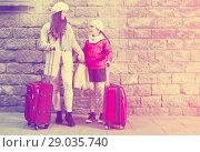 Купить «woman with child with baggage near wall», фото № 29035740, снято 19 ноября 2017 г. (c) Яков Филимонов / Фотобанк Лори