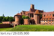 Купить «Gothic Castle of Teutonic Knights, Malbork», фото № 29035900, снято 13 мая 2018 г. (c) Яков Филимонов / Фотобанк Лори