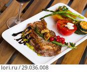 Купить «Veal with grilled vegetables», фото № 29036008, снято 27 июня 2018 г. (c) Яков Филимонов / Фотобанк Лори