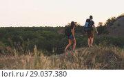 Купить «Travelers with backpacks», видеоролик № 29037380, снято 31 августа 2018 г. (c) Илья Шаматура / Фотобанк Лори