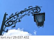 Купить «Декоративный фонарь на фоне неба. Бранево, Польша», фото № 29037432, снято 7 июня 2016 г. (c) Ирина Борсученко / Фотобанк Лори
