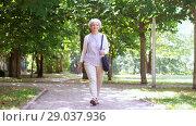Купить «happy senior woman walking along summer park», видеоролик № 29037936, снято 21 августа 2018 г. (c) Syda Productions / Фотобанк Лори