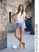 Купить «Young woman standing near old stone wall», фото № 29038640, снято 15 августа 2017 г. (c) Яков Филимонов / Фотобанк Лори