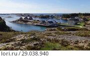 Купить «Panorama of a small village on the shore of the Norwegian fjord in sunny weather, Averoy, Norway (top view)», видеоролик № 29038940, снято 1 сентября 2018 г. (c) Некрасов Андрей / Фотобанк Лори