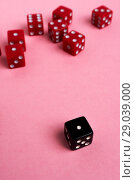 Купить «Red and black gaming dices on pink background», фото № 29039000, снято 3 января 2018 г. (c) Pavel Biryukov / Фотобанк Лори