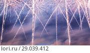 Купить «Celebratory colorful fireworks exploding in the skies», фото № 29039412, снято 10 августа 2013 г. (c) Владимир Журавлев / Фотобанк Лори