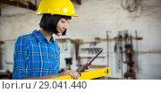 Купить «Composite image of female architect measuring plywood with engineer scale», фото № 29041440, снято 24 сентября 2018 г. (c) Wavebreak Media / Фотобанк Лори