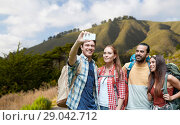 Купить «friends with backpack taking selfie by smartphone», фото № 29042712, снято 25 июля 2015 г. (c) Syda Productions / Фотобанк Лори