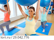 Купить «pregnant women training with exercise balls in gym», фото № 29042776, снято 5 марта 2016 г. (c) Syda Productions / Фотобанк Лори