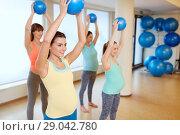 Купить «pregnant women training with exercise balls in gym», фото № 29042780, снято 5 марта 2016 г. (c) Syda Productions / Фотобанк Лори