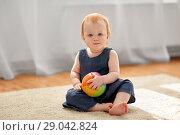 Купить «lovely redhead baby girl with toy ball at home», фото № 29042824, снято 26 апреля 2018 г. (c) Syda Productions / Фотобанк Лори