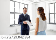 Купить «realtor showing contract document to customer», фото № 29042884, снято 8 июня 2018 г. (c) Syda Productions / Фотобанк Лори