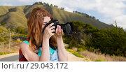 Купить «woman with backpack and camera at big sur hills», фото № 29043172, снято 25 июля 2015 г. (c) Syda Productions / Фотобанк Лори