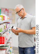 Купить «senior male customer with drug at pharmacy», фото № 29043200, снято 27 июня 2015 г. (c) Syda Productions / Фотобанк Лори