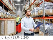 businessman and worker on forklift at warehouse. Стоковое фото, фотограф Syda Productions / Фотобанк Лори