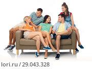 Купить «friends sitting on sofa over white background», фото № 29043328, снято 30 июня 2018 г. (c) Syda Productions / Фотобанк Лори