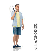 Купить «smiling young man with tennis racket», фото № 29043352, снято 30 июня 2018 г. (c) Syda Productions / Фотобанк Лори