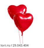Купить «two red heart shaped helium balloons», фото № 29043404, снято 6 марта 2018 г. (c) Syda Productions / Фотобанк Лори