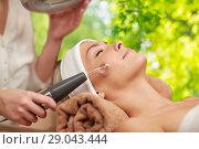 Купить «woman having hydradermie facial treatment in spa», фото № 29043444, снято 18 декабря 2014 г. (c) Syda Productions / Фотобанк Лори