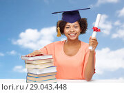 Купить «african graduate student with books and diploma», фото № 29043448, снято 8 июля 2015 г. (c) Syda Productions / Фотобанк Лори