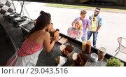 Купить «customers queue and saleswoman at food truck», фото № 29043516, снято 1 августа 2017 г. (c) Syda Productions / Фотобанк Лори