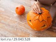 Купить «close up of woman with halloween pumpkin at home», фото № 29043528, снято 15 сентября 2017 г. (c) Syda Productions / Фотобанк Лори