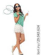 Купить «teen girl with badminton rackets and shuttlecock», фото № 29043624, снято 30 июня 2018 г. (c) Syda Productions / Фотобанк Лори