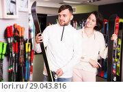 Купить «Couple choosing skis in shop», фото № 29043816, снято 6 февраля 2018 г. (c) Яков Филимонов / Фотобанк Лори