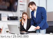 Купить «Dissatisfied manager scolding frustrated salesgirl at workplace in furniture salon», фото № 29043880, снято 9 апреля 2018 г. (c) Яков Филимонов / Фотобанк Лори