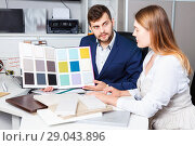 Купить «Competent seller in showroom helping young female client to choose furniture materials for her apartment», фото № 29043896, снято 9 апреля 2018 г. (c) Яков Филимонов / Фотобанк Лори