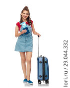 Купить «teenage girl with travel bag and air ticket», фото № 29044332, снято 30 июня 2018 г. (c) Syda Productions / Фотобанк Лори