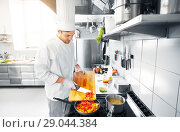 Купить «male chef cooking food at restaurant kitchen», фото № 29044384, снято 2 апреля 2017 г. (c) Syda Productions / Фотобанк Лори