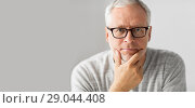 Купить «close up of senior man in glasses thinking», фото № 29044408, снято 7 июля 2016 г. (c) Syda Productions / Фотобанк Лори